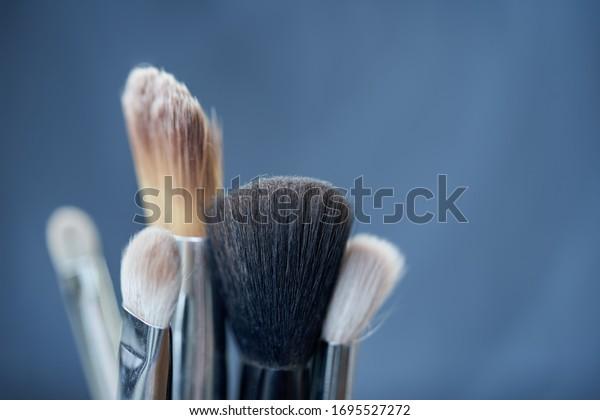 closeup-face-makeup-brushes-blurry-600w-