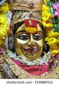 Closeup face photo of indian hindu goddess maa durga shakti idol in sacred temple on the occasion of navratri