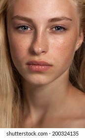 Close-up face portrait of young woman without make-up. Natural image without retouching w/shallow