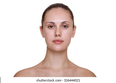 Close-up face portrait of young woman without make-up against white background