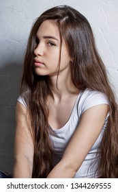 Closeup face teenager girl. Girl brunette asian. Vertical portrait fashion. Perfect young child model interracial appearance, looks confident, defiant
