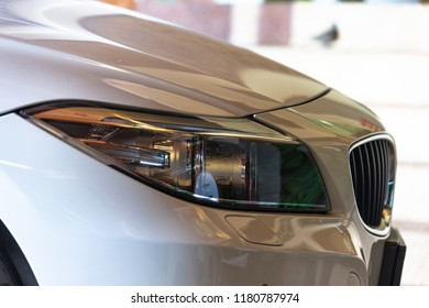 Close-up face of the white car.