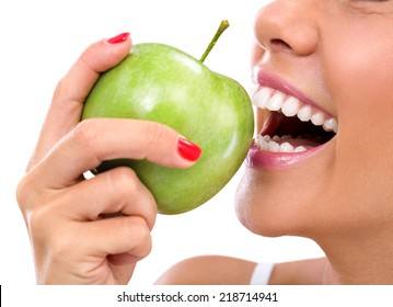 closeup of the face of a woman eating a green apple, isolated against white background