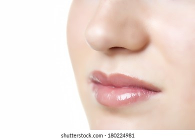 Closeup of a face of a woman with lips and nose