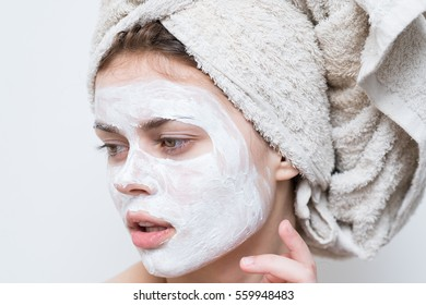 Close-up face of a woman in white mask cleaning
