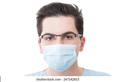 Closeup with the face of a young doctor wearing medical or surgical mask