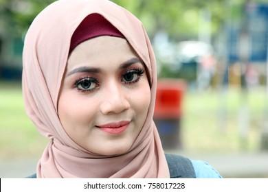 Closeup face of young pretty muslim wearing hijab girl with beautiful big  eyes, big eyelashes