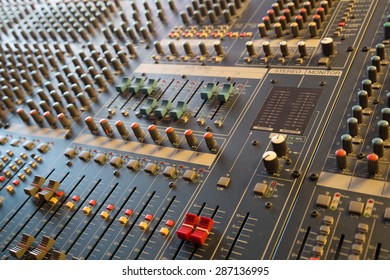 Close-up faders and knobs on professional audio musical mixer