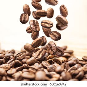 Closeup of falling or flying coffee beans on white background