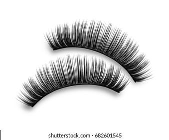 Close-up of false eyelashes on white background
