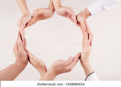 Close-up of family making circle from their hands and showing unity of their relationship isolated on white background