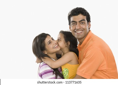 Close-up of a family smiling