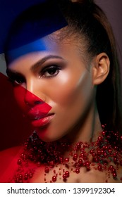 Close-up Fashion Make-up Red  and blue. Stylish African American Woman in Neon Light Background. Glamor makeup. Futuristic Abstract  Light Background - Image
