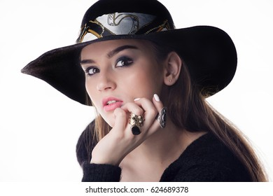 Closeup fashion portrait of young beautiful girl brunette fashion girl posing in Studio on white background, retro felt hat popular until the 60-ies.fashion