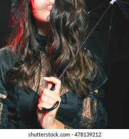 Closeup fashion young woman going to Halloween party 2016. Beautiful hairstyle and scary makeup! Secret. Doll with umbrella and hat. Halloween costumes. Entrance is limited to nightclub, dress code