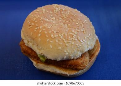 A closeup of a fastfood chicken sandwhich.