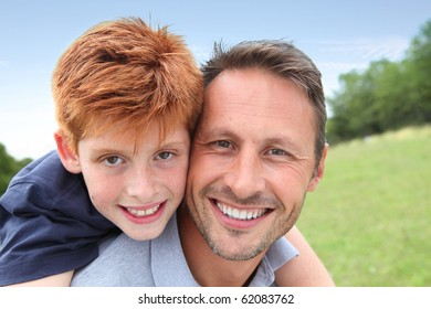Closeup of father and son in countryside