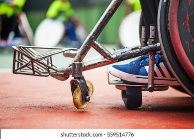 closeup of the feet on a wheelchair of a disabled person. wheelchair for a rugby play