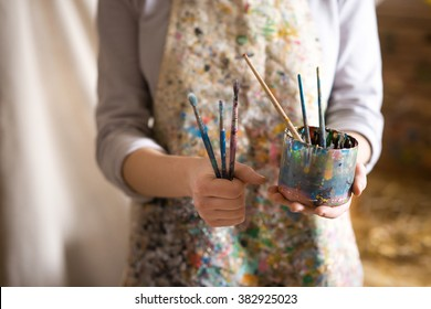 Closeup of female artist hand holding paintbrush
