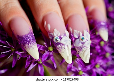 Close-up of female beautifully manicured nails in purple