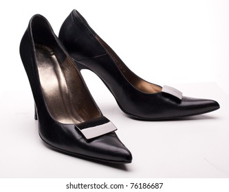 Close-up of female black high-heeled shoes over white background isolated, a lot of copyspace available.