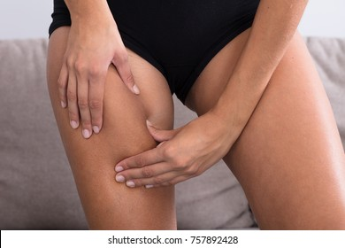 Close-up Of Female Checking Cellulite On Her Thigh At Home