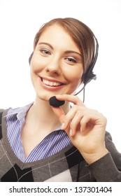 Closeup of female customer service representative smiling on white background