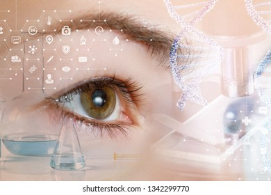 A closeup of a female eye looking straight behind the system of laboratory tools and equipment dna .
