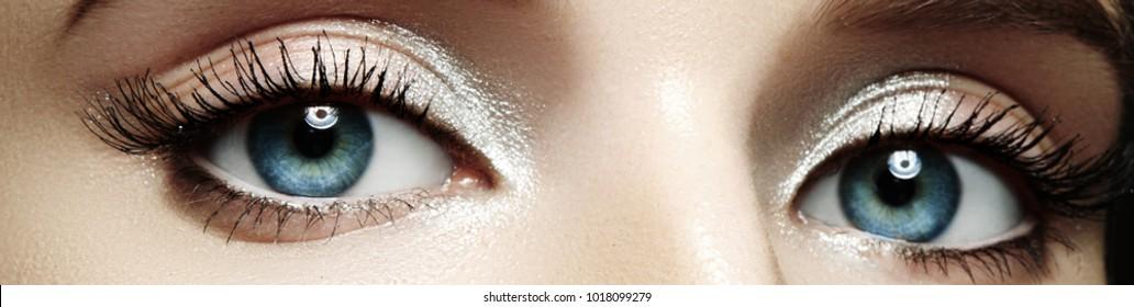 45e90cc32b9 Closeup female eyes with bright make-up, great shapes brows, extreme long  eyelashes
