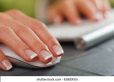 closeup of female hand on computer mouse