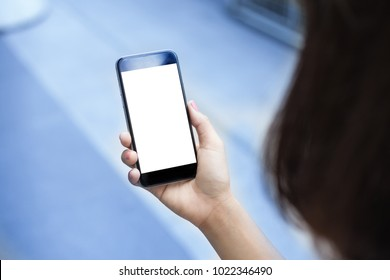 Close-up of Female hands holding white screen mobile smart phone