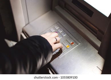 close-up of female hands on ATM keys selects the amount to cash out, blank screen for logo or place for design