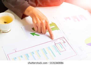 close-up of female  hands pointing at business document while analyze it