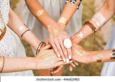 Close-up of female hands, three girls, best friends, flash tattoo, accessories, Bohemian, bo-ho style, indie hippie, ring, bracelet, manicure