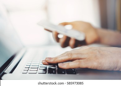 Close-up of female hands using laptop while checking his notifications or friends list at social networks, young blogger woman working from home on laptop