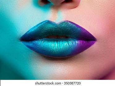 close-up of female lips with colored light