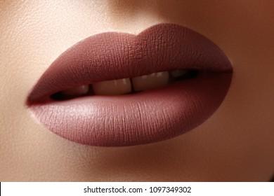 Close-up Female Lips with Fashion Natural coffee Lipstick Makeup. Macro Sexy Lip Stick Make-up. Beauty shot