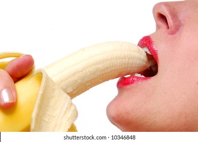Close-up female lips with red lipstick and peeled banana
