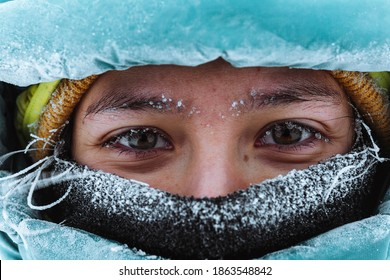 Closeup of a female mountaineer in wintertime at Glen Coe, Scotland