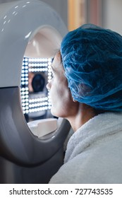Closeup of female patient and face analysis treatment. Woman's head in face scanner machine. Woman receiving face skin analysis.