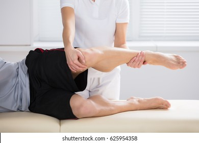 Close-up Of A Female Physiotherapist Giving Exercise In Clinic