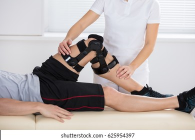 Close-up Of A Female Physiotherapist Giving Leg Exercise In Clinic