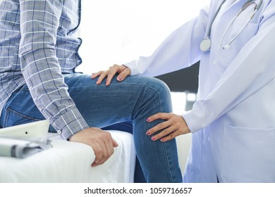 Close-up of female physiotherapist massaging the leg of patient in a physio room.