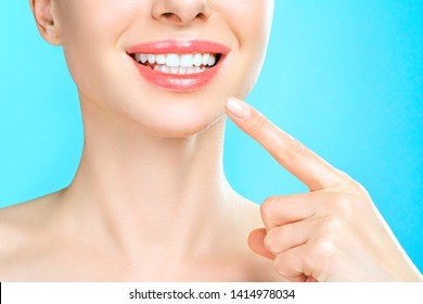 Closeup female portrait with toothy smile. Care, treatment, teeth whitening. Dentistry and health concept