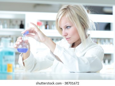 Closeup of a female researcher carrying out some experiments in a lab