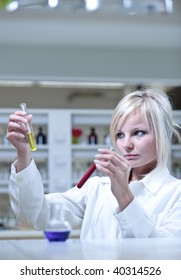 Closeup of a female researcher holding test tubes while carrying out some experiments in a laboratory