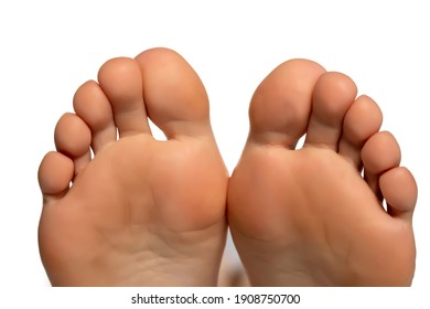 Closeup of a female toes  on a white background