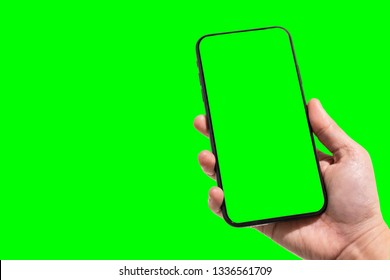 Close-up of female use Hand holding smartphone blurred images touch of green screen background.