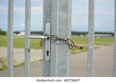 Close-up of fence locked with chain and padlock