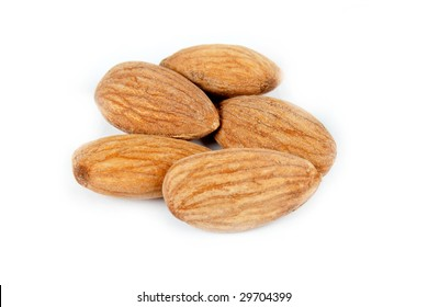 Close-up few almonds isolated on a white background.